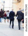 businessmen crossing the street in London - stock photo