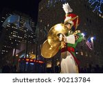 NEW YORK-DEC 2 : A Large toy drummer statue and the holiday lights in Rockefeller Center on December 2, 2011. - stock photo