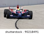 MILWAUKEE, WI - MAY 30: Race Driver Dan Wheldom Pilots his #4 National Guard INDYCAR around corner one of the famous Milwaukee Mile May 30, 2009 in Milwaukee, WI. 2009 marked his return to Panther. - stock photo