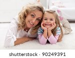 Spending time with mother just relaxing - little girl and woman at home - stock photo