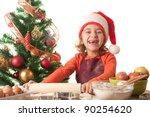 Merry Christmas - little girl baking Christmas cookies - stock photo