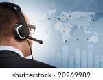 Flight control manager viewing the screen with airplanes around the world - stock photo