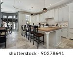 Stock photo kitchen in luxury home with wood counter island 90278641