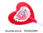 Red heart shape candy isolated on white background. - stock photo