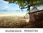 Woman Lying In A Hammock In...