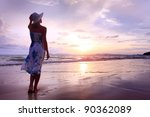 Woman In Summer Dress Standing...