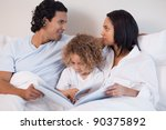 young family sitting on the bed ... | Shutterstock . vector #90375892