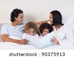young family reading a story in ... | Shutterstock . vector #90375913