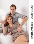 smiling young couple relaxing... | Shutterstock . vector #90390223