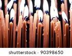 burning orange candles close up | Shutterstock . vector #90398650
