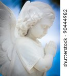 Child Angel Statue With A Blue...
