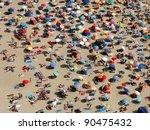 Sun Umbrellas On A Crowded Beach