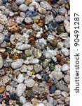Colored Pebbles Under Water At...