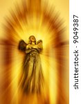 statue of angel in gold light - stock photo