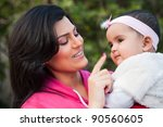 indian family  mother holding... | Shutterstock . vector #90560605