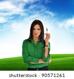 Beautiful businesswoman in green shirt, outdoor portrait. Clouds in the background. - stock photo