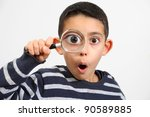 funny boy looking through... | Shutterstock . vector #90589885