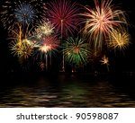 Fireworks celebration on the lake - stock photo