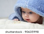 Stock photo cute baby looking out from under blanket 90635998