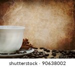 White coffee cup in front of a grunge wall - stock photo