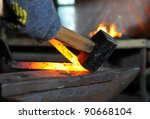 Blacksmith Forges A Red Hot...