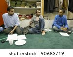 Small photo of NEW YORK - JAN 4: Sameer Hajee (C) speaks about tsunami recovery ideas with Sajjad Mamdani (L), Imran Shivji (R) and others at the Al-Husseini Madressa Center mosque January 4, 2005 in Woodside.