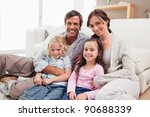 family relaxing on a sofa in a... | Shutterstock . vector #90688339
