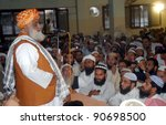 Small photo of KARACHI, PAKISTAN - DEC 12: Jamiat Ulema-e-Islam-F Ameer, Mulana Fazl-ur-Rehman addresses to party workers during a meeting held on December 12, 2011 in Karachi.