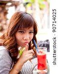 woman drinking fruit shakes on... | Shutterstock . vector #90714025