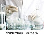 Chemical research. Soft-focused, focal point is on bottles - stock photo