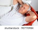 senior man relaxing on sofa... | Shutterstock . vector #90770984