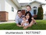 portrait of happy family lying... | Shutterstock . vector #90770987