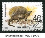 YEMEN REPUBLIC - CIRCA 1990: A stamp printed in Yemen shows Edaphosaurus, series devoted to prehistoric animals, circa 1990. - stock photo