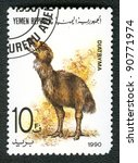 YEMEN REPUBLIC - CIRCA 1990: A stamp printed in Yemen shows Diatryma, series devoted to prehistoric animals, circa 1990. - stock photo