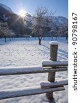 Snow Covered Wooden Fence With...