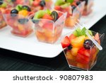 Fruit Cups On A White Plate