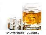 whiskey in glass with ice cubes | Shutterstock . vector #9080863