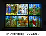Small photo of A colorful six pane stained glass church window