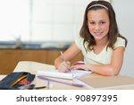 smiling girl doing her homework ... | Shutterstock . vector #90897395
