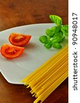 Spaghetti with tomatoes and basil, a typical Italian recipe - stock photo
