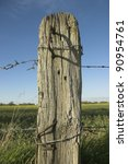 Weathered Wooden Post With...