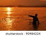 Fishing net on sunset - stock photo