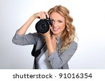 Woman Using Photo Camera In...