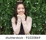 A smile of Asia beautiful girl  on a background of green nature - stock photo