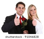 A Girl And Guy With A Thumbs U...