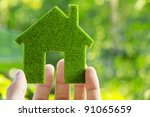 hand holding eco house icon... | Shutterstock . vector #91065659