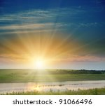 good sunset over field and river - stock photo