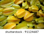 A pile of tropical star fruit in Bangkok morning market. - stock photo