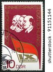 GERMANY - CIRCA 1976: A stamp printed in Germany shows Lenin, Marx, Engels and dedicated at the IX congress of the socialistic party of Germany, circa 1976 - stock photo