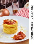 pie of cornmeal with sausages sauce italian recipe - stock photo